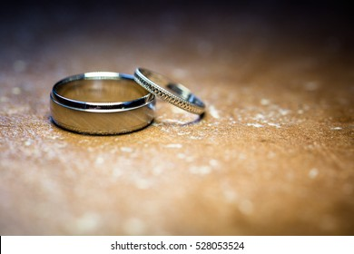 Isolated wedding rings on textured stone background