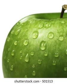 Isolated wet apple (granny smith)