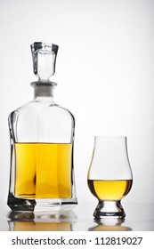 isolated whiskey glass and bottle