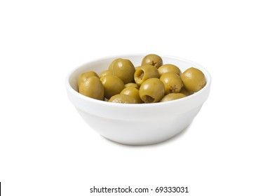 isolated white bowl with green tinned olives