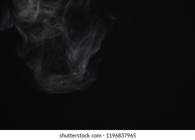 Isolated white smoke overlay effect on solid super black background. Nature motion smoky steam wave abstract environment pollution, cigarette, gas, dry ice, chemistry, factory. Halloween spooky ghost