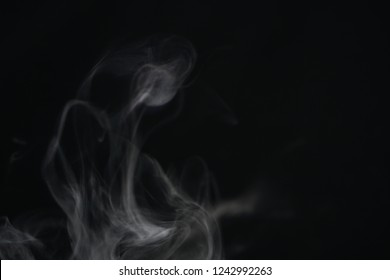 Isolated white smoke overlay effect on solid super black background. Nature motion smoky steam wave abstract environment pollution, cloud, cigarette, gas, dry ice, chemistry, factory and ghost concept