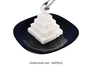 isolated white sugar pyramid on a plate