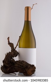 Isolated White Wine Bottle in a White Background, fresh and Clean with Gold Capsule, White Label and a Vine