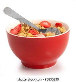 isolated wholegrain muesli breakfast, with lots of dry strawberries