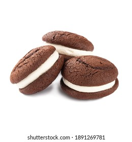 Isolated whoopie pies with chocolate pastry and cream on the white background