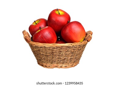 isolated wicker basket of red apples