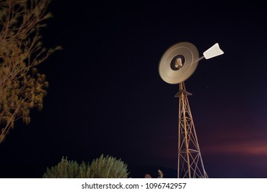 Isolated windmill at mine site camp with sunset on the background Pilbara region Perth Western of Australia