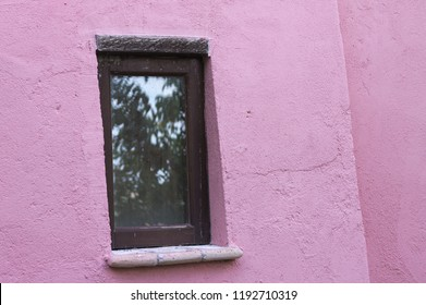 Isolated window of a pink house (Marche, Italy, Europe)