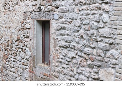 Isolated window in a stone wall (Marche, Italy, Europe)