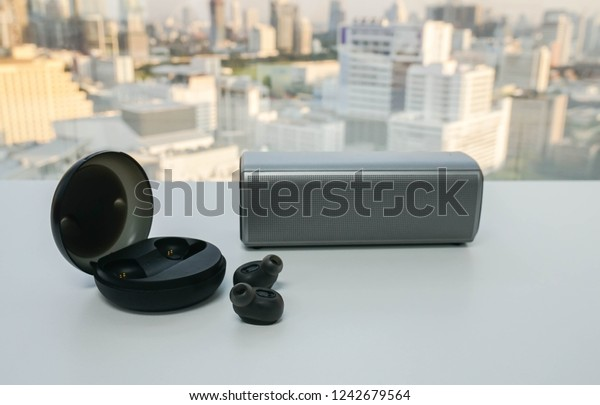 isolated wireless modern earphone with portable speaker for listening music in office