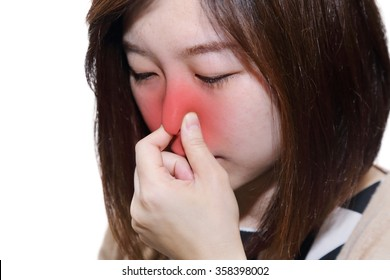 isolated woman with a running nose with a hand grabbing her nose