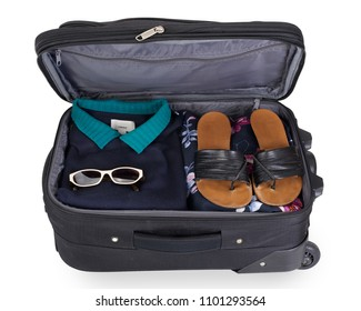 Isolated woman's suitcase for a short vacation or city trip