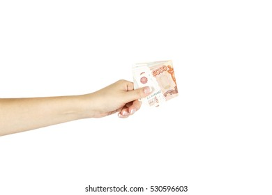 Isolated women's hand holds five thousand roubles on a white background.