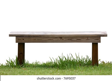 Isolated wood bench on green grass.