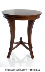 Isolated wooden end table or night stand. Seen from a straight on view which mostly obscures two of four legs. Reflection grounds table and adds class or can be easily removed.