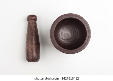 Isolated wooden garlic masher on white background (different angles)