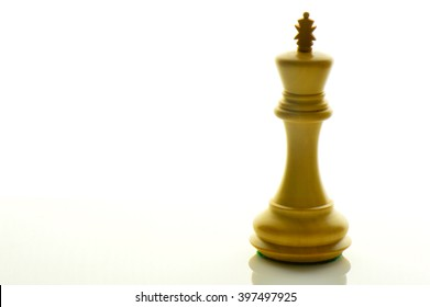 An isolated wooden King on white background.Concept of leadership.