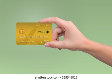 Isolated yellow credit card in woman hand on green background