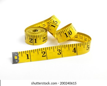 Isolated yellow tape measure on white