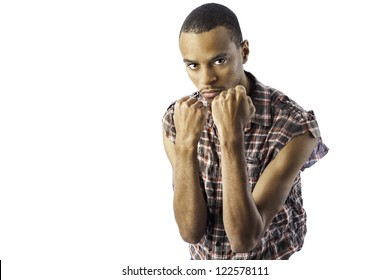 isolated young african american black male in a defensive fighting stance where he could be defending or be the aggresor