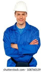 Isolated young attractive repairman posing with style