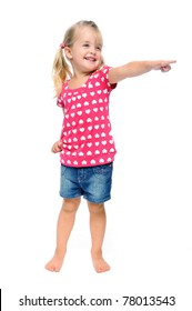 isolated young blonde girl points out of frame, good area for copyspace