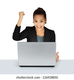 Isolated young business woman working on a table