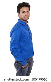 4529993a61 Isolated young Indian male model in blue shirt side pose