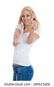 Isolated young successful blond female student with thumbs up on white.