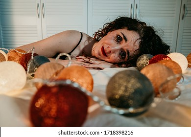 Isolated young woman at home due to coronavirus pandemic. Crying desperate with the mascara running trough her cheeks. Sad and hopeless. Bad emotion