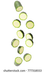 Isolated zucchini. Falling courgettes isolated on white background with clipping path