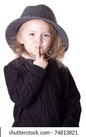 An isolationg of a cute girl on white.  She has her finger over her lips and is asking a question.