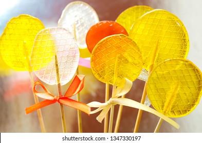Isomalt lollipops cockerels on sticks candies. Candy, lollipop, bonbon, no-sugar candy. Sweetmeat no sugar added. Isomalt lollipop dessert. Healthy candy background. No sugar added lollipop.