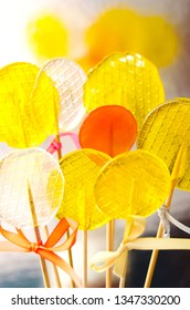 Isomalt lollipops cockerels on sticks candies. Candy, lollipop, bonbon, no-sugar candy. Sweetmeat no shugar added. Isomalt lollipop dessert. Healthy candy background.