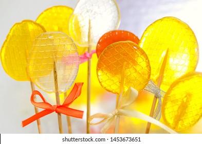 Isomalt lollipops cockerels on sticks candies. Candy, lollipop, bonbon, no-sugar candy. Sweetmeat no sugar added. Isomalt lollipop dessert.
