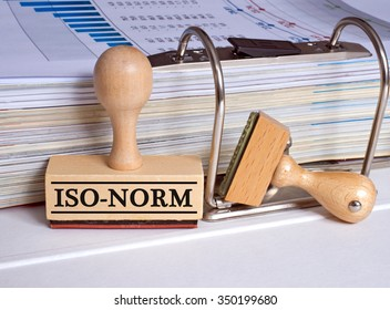 Iso-Norm rubber stamp with binder in the office
