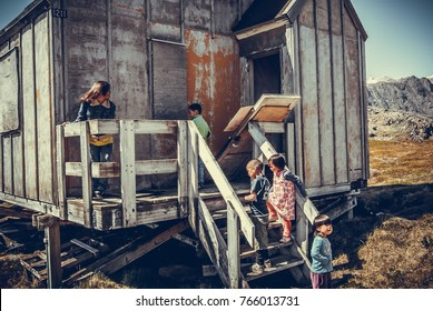 Isortoq, Greenland / June 21 2013 : Inuit's childrens are playing in an abandonned house