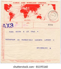 "ISRAEL - CIRCA 1934: An old printed in England telegram form (campaign poster) sent from Haifa to London showing red map of the world with inscription ""Cable and Wireless Limited"", series, circa 1934"