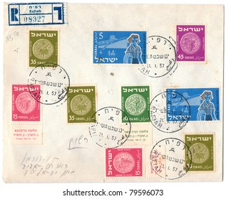 ISRAEL - CIRCA 1957: An old used Israeli envelope (campaign poster) with nine postage stamps issued in honor of the Israels Re-Opening of the Rafiah Post Office, series, circa 1957