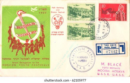 """ISRAEL - CIRCA 1957: A vintage Israeli used envelope showing dancing youth, a torch with inscription on a green background """"Moscow Youth Festivals. Folk Dancing and Drama Festival"""", series, circa 1957"""