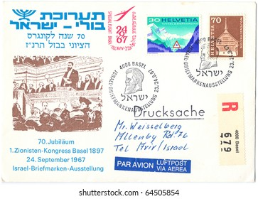 """ISRAEL - CIRCA 1967: An old used envelope showing the meeting of the First Zionist Congress in Basel with inscription """" 70-th anniversary of the first Zionist Congress in Basel"""", series, circa 1967"""