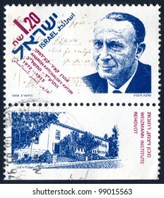ISRAEL - CIRCA 1993: An used Israeli postage stamp issued in honor of an Israeli pioneer in the study of the electrochemistry of biopolymers Aharon Katzir-Katchalsky (1914 - 1972); series, circa 1993