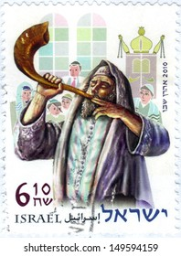 "ISRAEL - CIRCA 2010: A stamp printed in Israel, shows a religious jew blowing to the shofar, from the series ""festivals 2010"", circa 2010"
