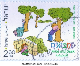 ISRAEL, CIRCA 2011. One old used postage stamp dedicated to children's coordination games. Hide and seek. Series, circa 2011.