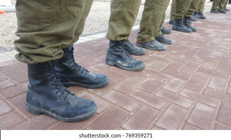 Israel Defense Force reserve soldiers standing outside, only their feet seen with military boots. Israeli soldiers stock image.