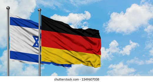 Israel and Germany flag waving in the wind against white cloudy blue sky together. Diplomacy concept, international relations.