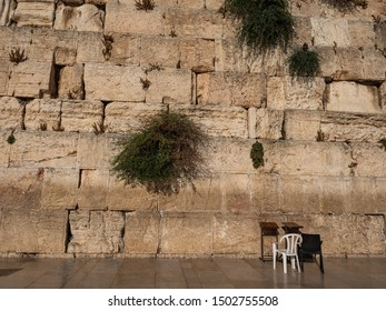 Israel historic religion Western Wall with two chairs for praying