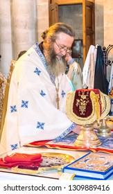 Israel / Jerusalem - 03/26/2016: An Orthodox priest celebrates the Liturgy in the Church of the Holy Sepulcher. Resurrection of Christ.