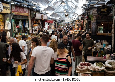 ISRAEL, JERUSALEM 10 October 2019: crowded Machane Yehuda Market, fresh market in Jerusalem with fresh vegetables and fruits